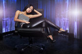 Beautiful asian woman sitting on armchair in room — Stock Photo