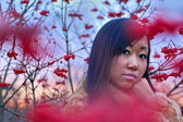 Beautiful asian woman near berry — Stock Photo