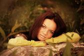Woman recline on tree — Stock Photo