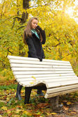 Woman in autumn — Stock Photo