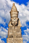Old satue of sphynx with bright sky on background — Stock Photo