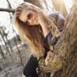 Woman lay on a tree trunk — Stock fotografie