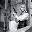 Woman with pistol — Stock Photo