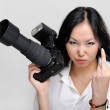 Asian woman with photo camera — Stock Photo