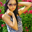 Asian woman in sunglasses - Stock Photo