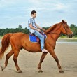 Stock Photo: Man riding a horse