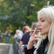 Girl smoking outdoors — Stock Photo