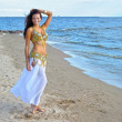 Beautiful woman in white exotic dress near sea — Stock Photo #10472299