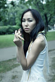 Asian woman with snake — Stock Photo