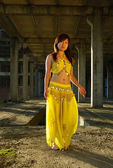 Pretty girl dancing in indian dress — Stock Photo