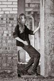 Woman recline on brick wall — Stock Photo