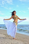 Beautiful woman dancing in white indian dress — Stock Photo