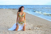 Beautiful sitting woman in exotic dress — Stock Photo