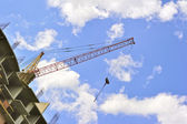 Building with elevating crane — Stock Photo