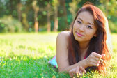 Asian womanl in a field — Stock Photo
