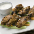 Cooked chicken wings on plate — Stock Photo