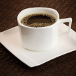 Simple dark coffee cup with brew — Stock Photo