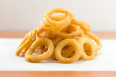 Onion ring on a waxed white paper — Stock Photo