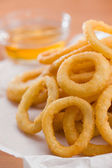 Onion ring with honey sauce — Stock Photo