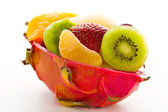 Fruit salad in a cuted pitahaya — Stock Photo