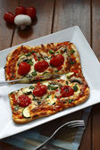 Cutted vegetarian pizza — Stock Photo