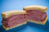 Sliced smoked meat beef sandwich — Stock Photo