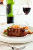 Surf and turf with wine — Stock Photo