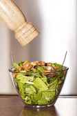 Caesar salad and pepper — Stock Photo