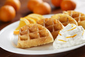 Orange fruit waffles — Stock Photo