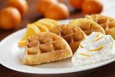 Orange fruit waffles — Stock Photo