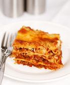 Fresh lasagna on white background — Stock Photo