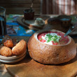 Ukrainian borscht in bread — Stock Photo