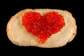 Heart from red caviar — Stock Photo