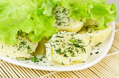 Boiled Potatoes and Salad Leaves — Stock Photo