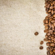 Coffee Beans on Burlap, Hessian, Sacking Background — Stock Photo #10483971