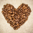 Heart from Coffee Beans on Burlap, Hessian background — Stock Photo