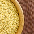 Cleaned Millet in a Serving Bowl on a Bamboo Mat — Stock Photo