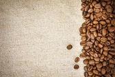 Coffee Beans on Burlap, Hessian, Sacking Background — Stock Photo