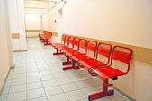 Red metal benches — Stock Photo