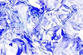 Imitation ice on blue background — Stock Photo