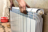 Real photo of installation of a radiator — 图库照片