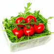 Royalty-Free Stock Photo: Red tomatoes and green arugula, isolated on the white