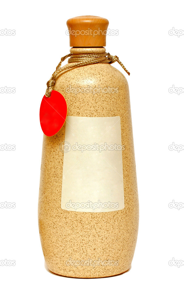 Clay bottle on a white background close up — Stock Photo #9931722