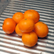 Tangerines on a metal kitchen surface — Stock Photo
