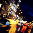 Moving car through city at night — 图库照片