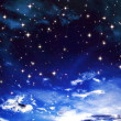 Bright stars in the blue cloudy sky — Stock Photo