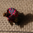 A traditional dressed Bolivian Woman Carries her Goods to the Market - Stock Photo