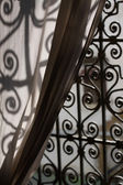 An elegant iron window in a Moroccan Market draped by a Curtain — Stock Photo