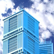 Royalty-Free Stock Photo: Modern skyscraper on cloudscape background