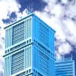 Modern skyscraper on cloudscape background — Stock Photo #10009490